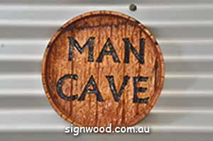 man cav wood sign
