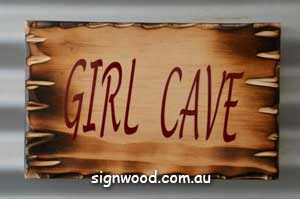 girl cave wood sign