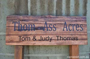 thom-ass acres wood sign